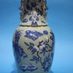 A late 19th century Chinese Celadon vase, decorated in blue relief. 41 cm high. Sold in our 11th January Antique and Interiors sale for £600